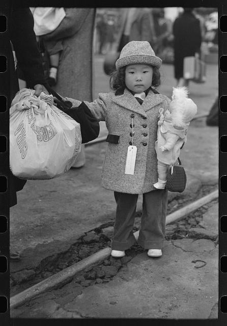 Child waiting to be taken to Manzanar April 1942 LC-DIG-fsa-8a31173
